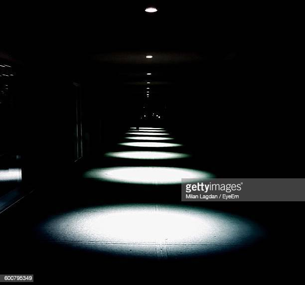 Row Of Illuminated Spot Lights In Hallway