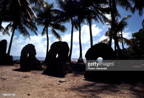 A row of large rai or stone money on Yap Island in Micronesia a group of islands in the Western Pacific Ocean The large limestone circular stone...