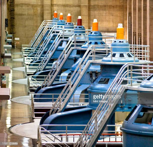 row of large turbines - hydroelectric power stock pictures, royalty-free photos & images