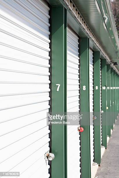 a row of locked storage units at a self storage facility - self storage stock pictures, royalty-free photos & images