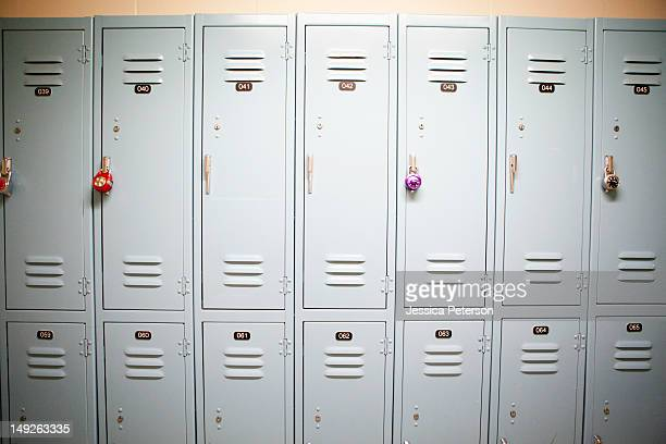 Row of lockers with different padlocks