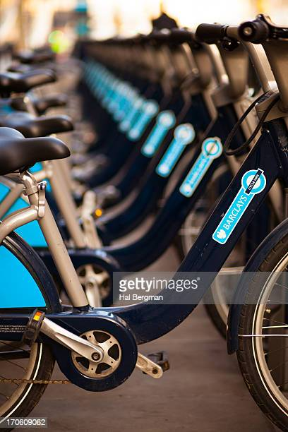 CONTENT] A row of London Bike Share bicycles with the Barclays Cycle Hire logo are available for borrowing for a short time in the City of London