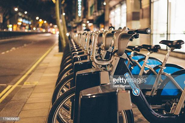 CONTENT] A row of London hire bikes line the street