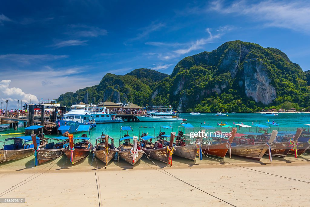 Row of longtail boats at Phi Phi island : Stock Photo