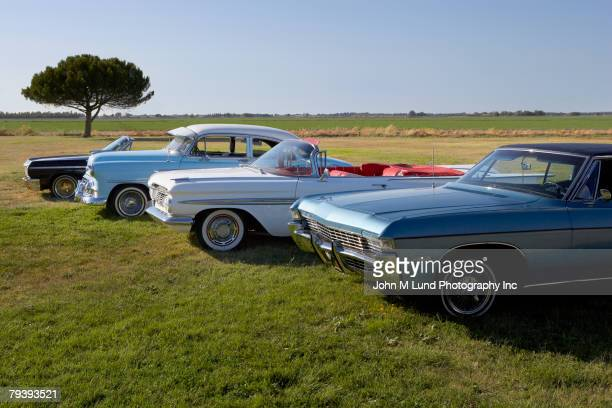 row of low rider show cars - motor show stock pictures, royalty-free photos & images