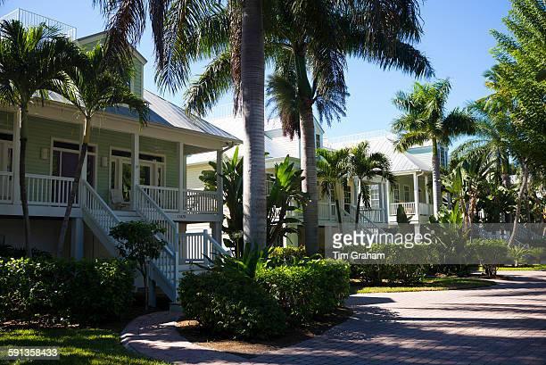 Row of luxury stylish winter homes with sundeck and palm trees downtown on Captiva Island in Florida USA