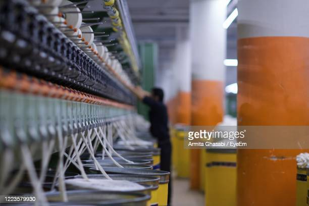 row of machines in factory - iran stock pictures, royalty-free photos & images