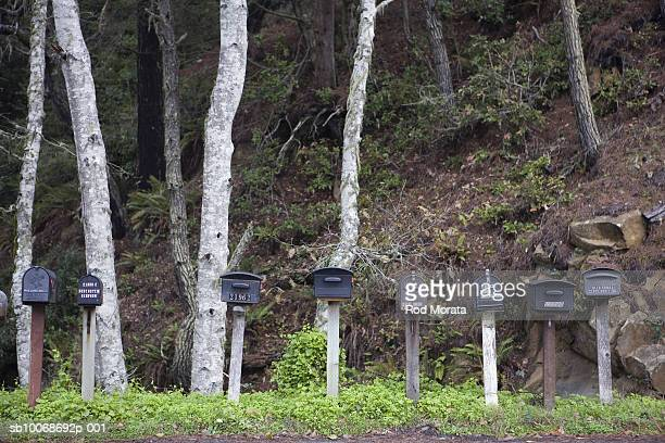 row of mail boxes - domestic mailbox stock pictures, royalty-free photos & images