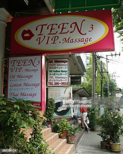 A row of massage parlors that specialize in sex with teenage masseuses in Bangkok the sex capital of the world