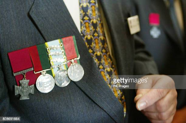 A row of medals including the Victoria Cross are displayed during a service at Westminster Abbey London attended by Queen Elizabeth II unveiling the...