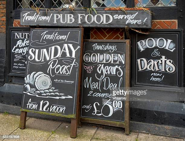 Row of menu boards outside a pub