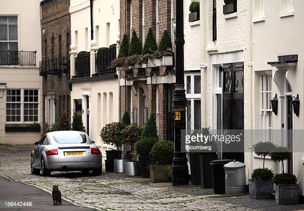 A row of mews houses are seen in the London area of Belgravia in London UK on Thursday Nov 15 2012 London luxury homes won't rise in value next year...