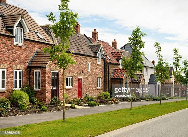 row of modern houses - britain stock pictures, royalty-free photos & images