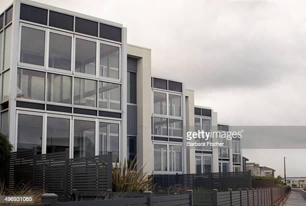 Row of modern suburban dwellings.