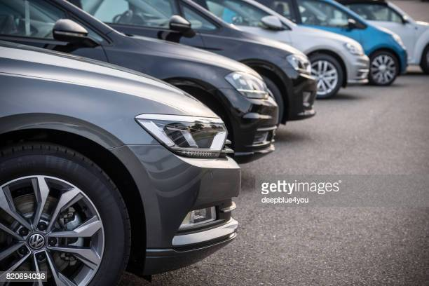 a row of modern vehicles standing on a public parking space in hamburg, germany - volkswagen stock pictures, royalty-free photos & images