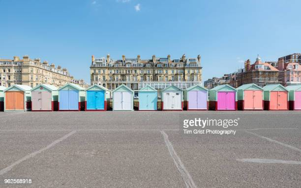 a row of multi-coloured beach huts along the promenade at hove, uk - sussex stock pictures, royalty-free photos & images
