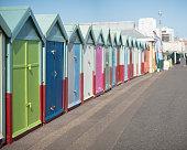 row multicoloured beach huts along promenade