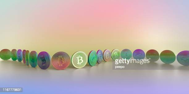 Row of Multi-Coloured Bitcoin's Arranged In Curve Against Colourful Background