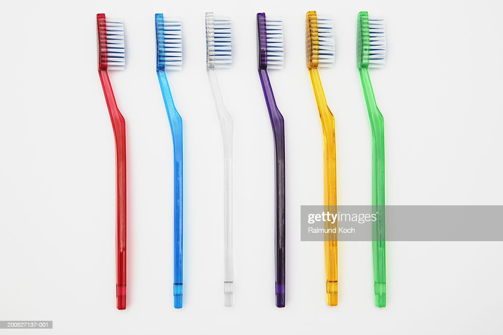 Row of multi-coloured toothbrushes : Stock Photo