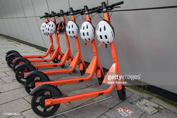 Row of Neuron Mobility e-scooters is pictured on 26th November 2020 in Slough, United Kingdom. Neuron Mobility launched a rental trial scheme in...