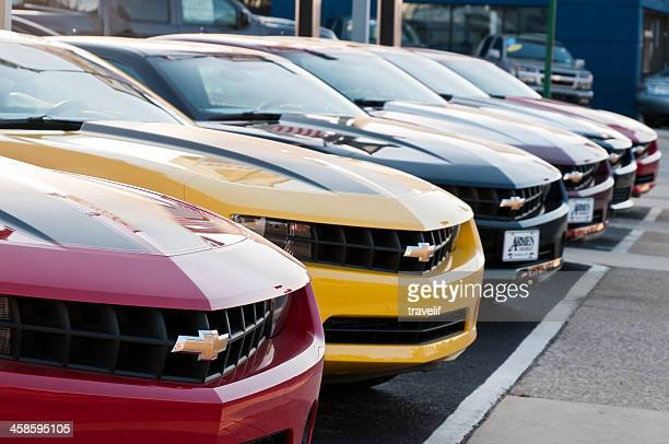 row of new chevrolet camaro cars on display - chevrolet camaro stock photos and pictures