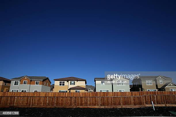 A row of new homes stand at a housing development on December 4 2013 in Dublin California According to a Commerce Department report sales of single...