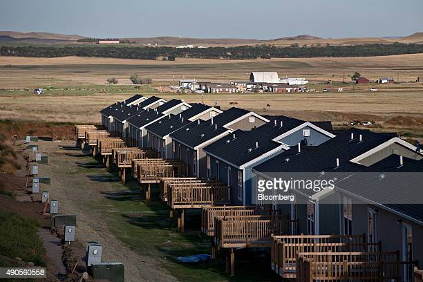A row of new homes stands in a development in Watford City North Dakota US on Thursday Sept 10 2015 After struggling to house thousands of migrant...