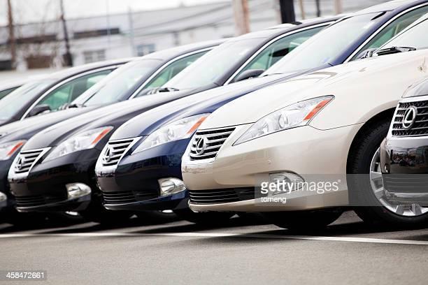 Row of New Lexus Vehicles at Car Dealership