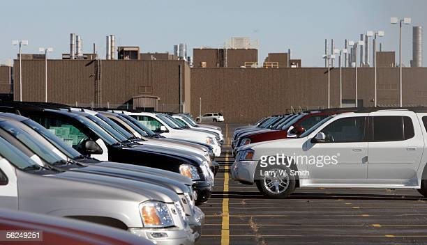 A row of new SUV's sit in a parking lot outside a General Motors Corp plant November 21 2005 in Oklahoma City Oklahoma Rick Wagner chairman and CEO...