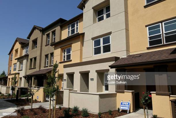 A row of newly constructed homes wait for buyers at a housing development April 23 2010 in Hayward California Sales of new homes surged nearly 27...
