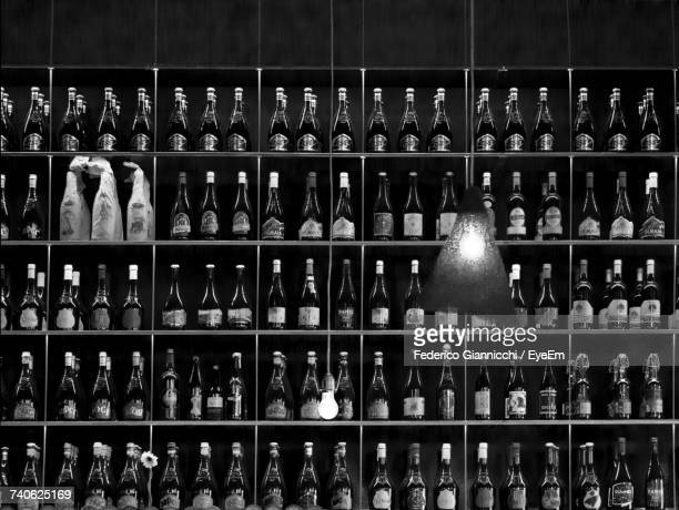 row of objects in shelf - liquor store stock pictures, royalty-free photos & images