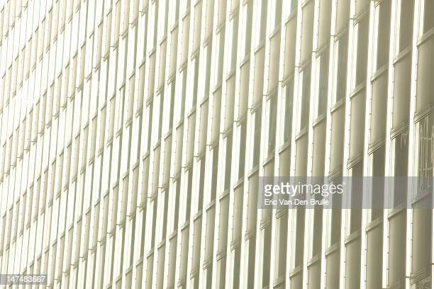 row of office building windows - eric van den brulle stockfoto's en -beelden