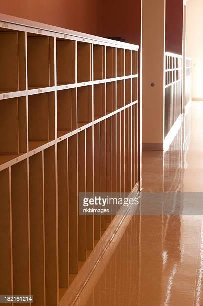 Row of open school cubbies in hallway