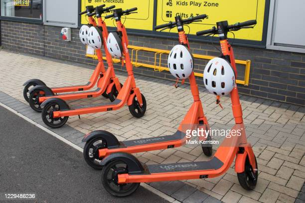 Row of orange Neuron Mobility e-scooters is pictured on 23 October 2020 in Slough, United Kingdom. Neuron Mobility have launched a rental trial in...