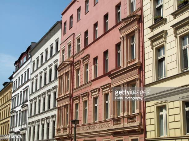 row of ornate pre-war residential buildings in the district of prenzlauerberg, berlin, germany - prenzlauer berg stock photos and pictures