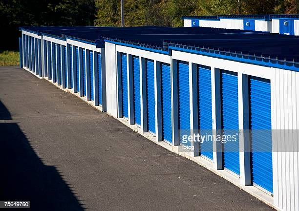 row of outdoor self storage units - self storage stock pictures, royalty-free photos & images