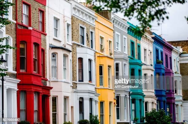 A row of painted houses is pictured in the Notting Hill district of west London on August 8 2017 Last week The Bank of England cut its UK growth...