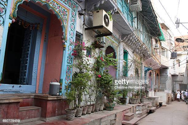 Row of painted old homes in a quiet street in Old Delhi, India