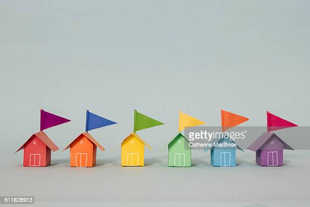 a row of paper beach huts - catherine macbride stockfoto's en -beelden