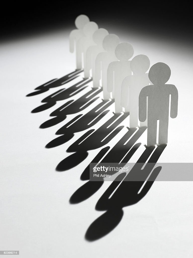 row of paper men cut outs : Stock Photo