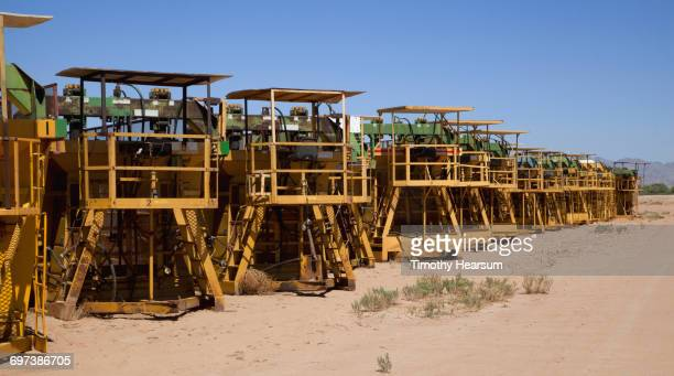 row of parked cotton baling machines - blythe brown stock pictures, royalty-free photos & images
