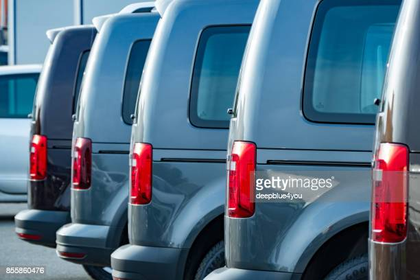 row of parked vw vans - out of frame stock pictures, royalty-free photos & images