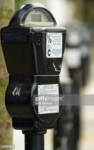 A row of parking are seen on a London street on July 7 2004 in London England Money raised in England by parking fines meters residential parking...