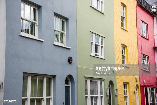 row of pastel coloured houses - multi coloured stock pictures, royalty-free photos & images