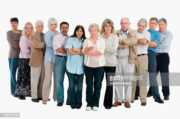 a row of people standing with their arms crossed - mad person picture stock photos and pictures