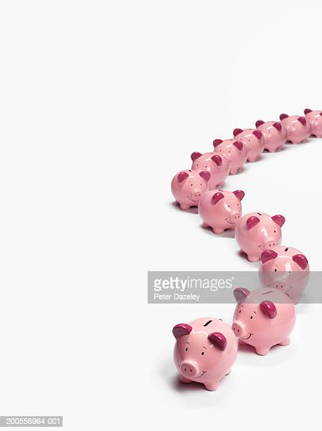 Row of piggy banks on white background