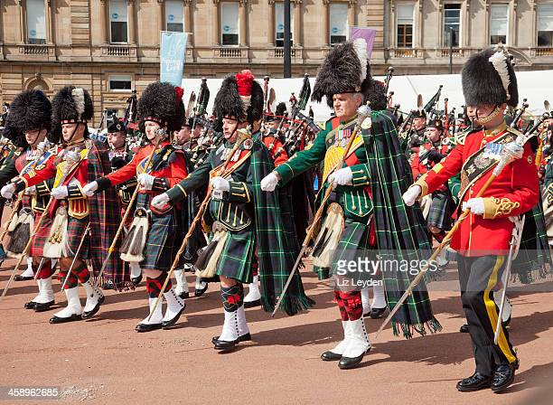 row of pipe majors, massed bands, glasgow - george square stock photos and pictures