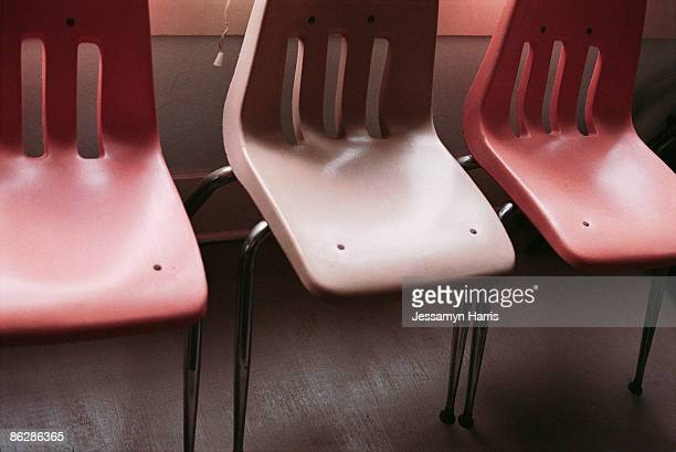 row of plastic chairs - jessamyn harris stock pictures, royalty-free photos & images