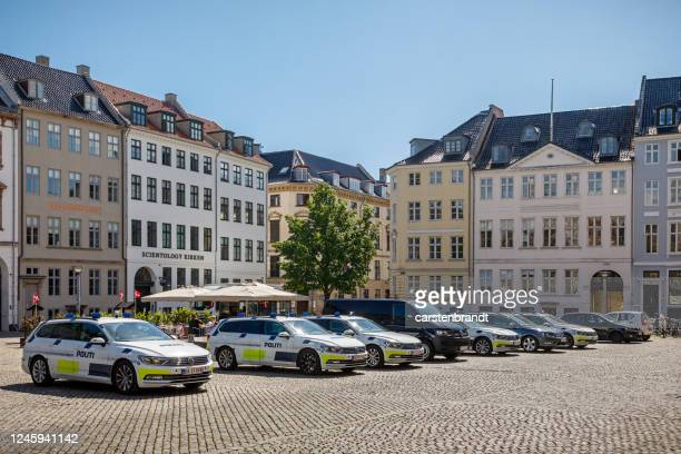 row of police cars in a city square - danish culture stock pictures, royalty-free photos & images