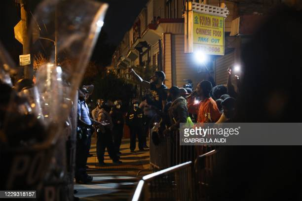 A row of police face demonstrators in Philadelphia on October 27 during a protest over the police shooting of 27yearold Black man Walter Wallace...